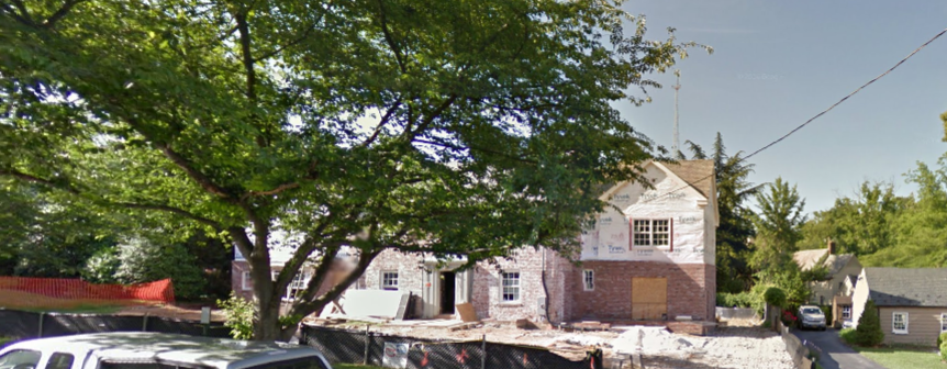This image from Google Maps shows the original, central core of the house with the side additions being built.