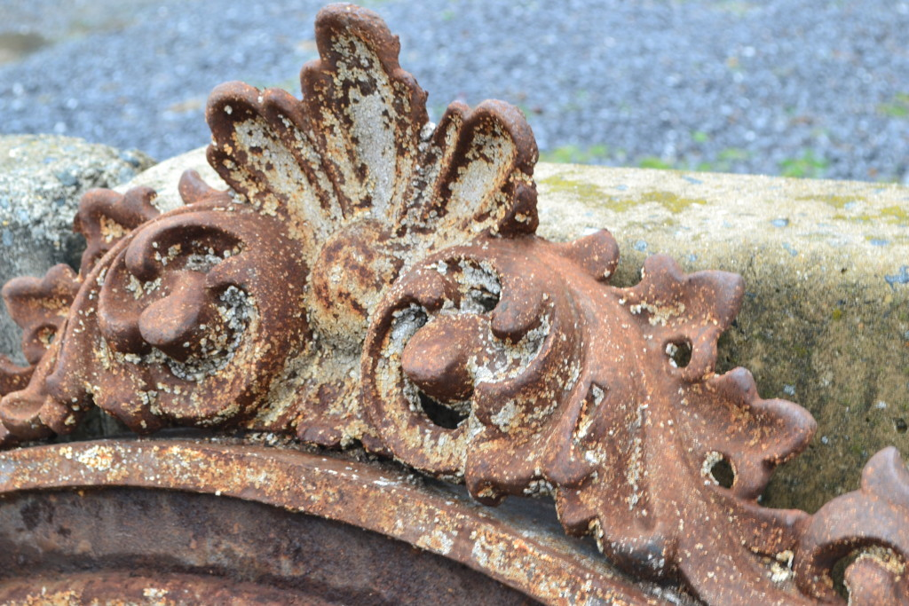 Detail of one of the salvaged iron arches.  This one's my favorite - notice the lichen that's grown in its crevices.  Perfect.