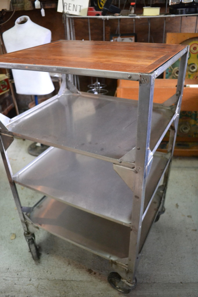 Stainless steel and wood on wheels.  Perfect look and great storage for your kitchen, office, laundry or craft room.