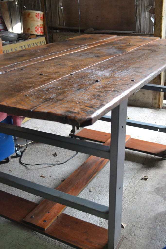 Fabulous, aged farm-table top on an industrial base.  Counter-height.  Perfect island for an eat-in kitchen.  Enough space to tuck in 6 stools - have them out of the way while you're working, and pull them right out when you're not.