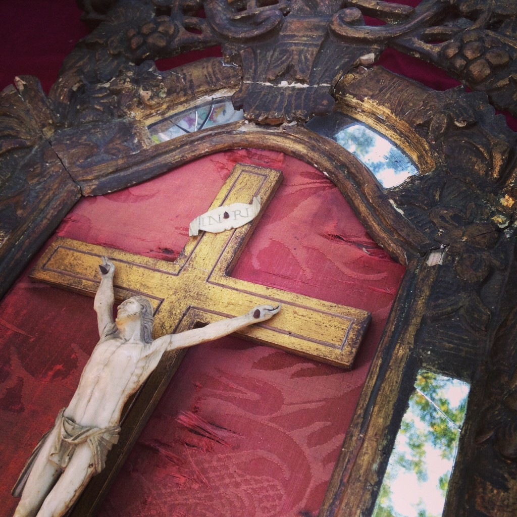 A quietly elegant, framed crucifix from a Paris flea market