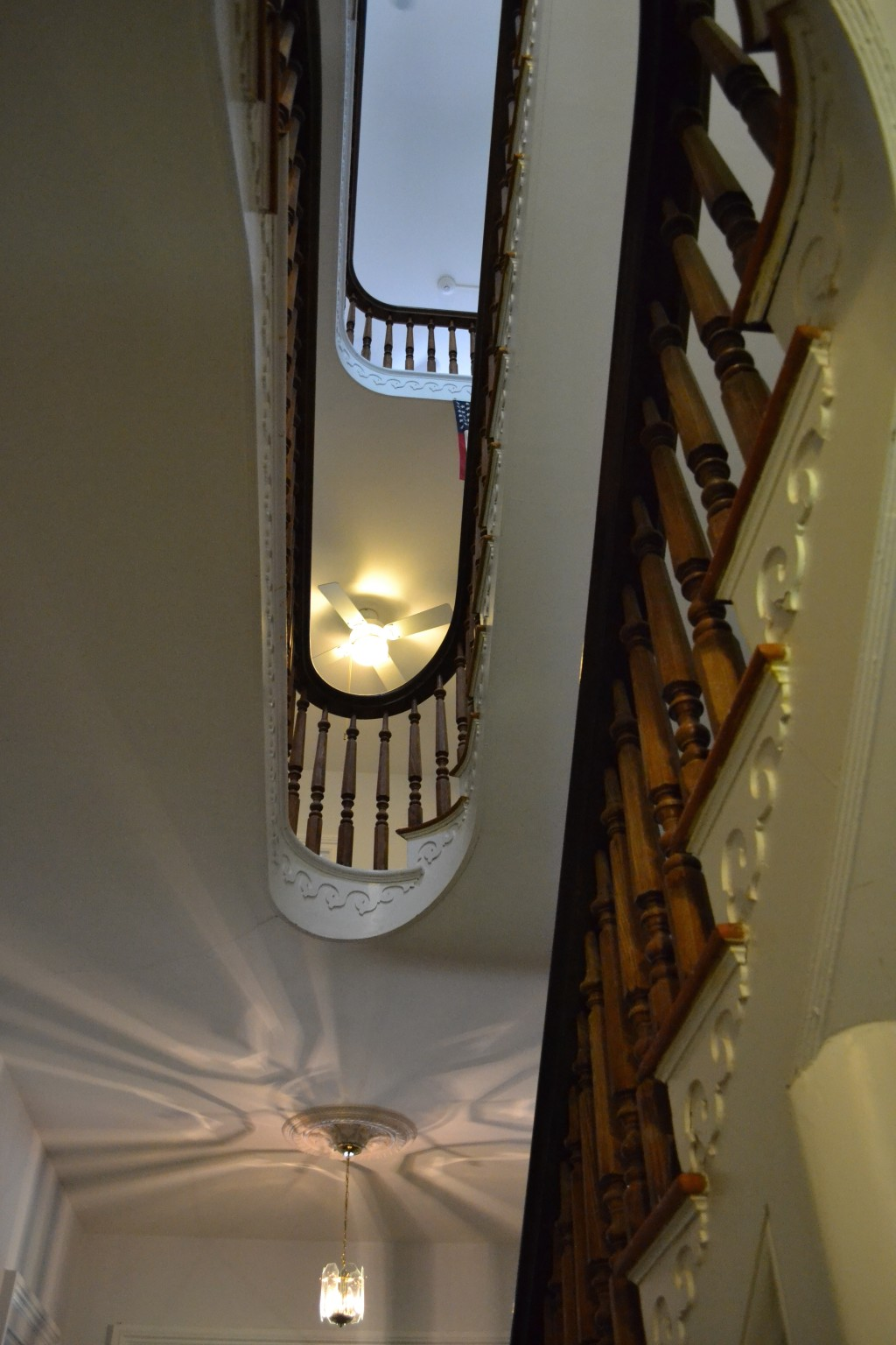 Extraordinary, three-full story, winding stairway.