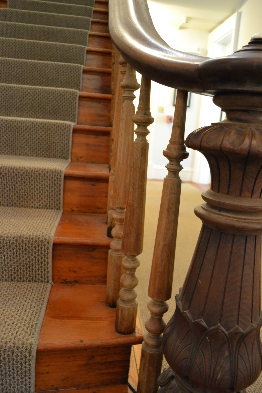 The solid wood newel post and ballisters.