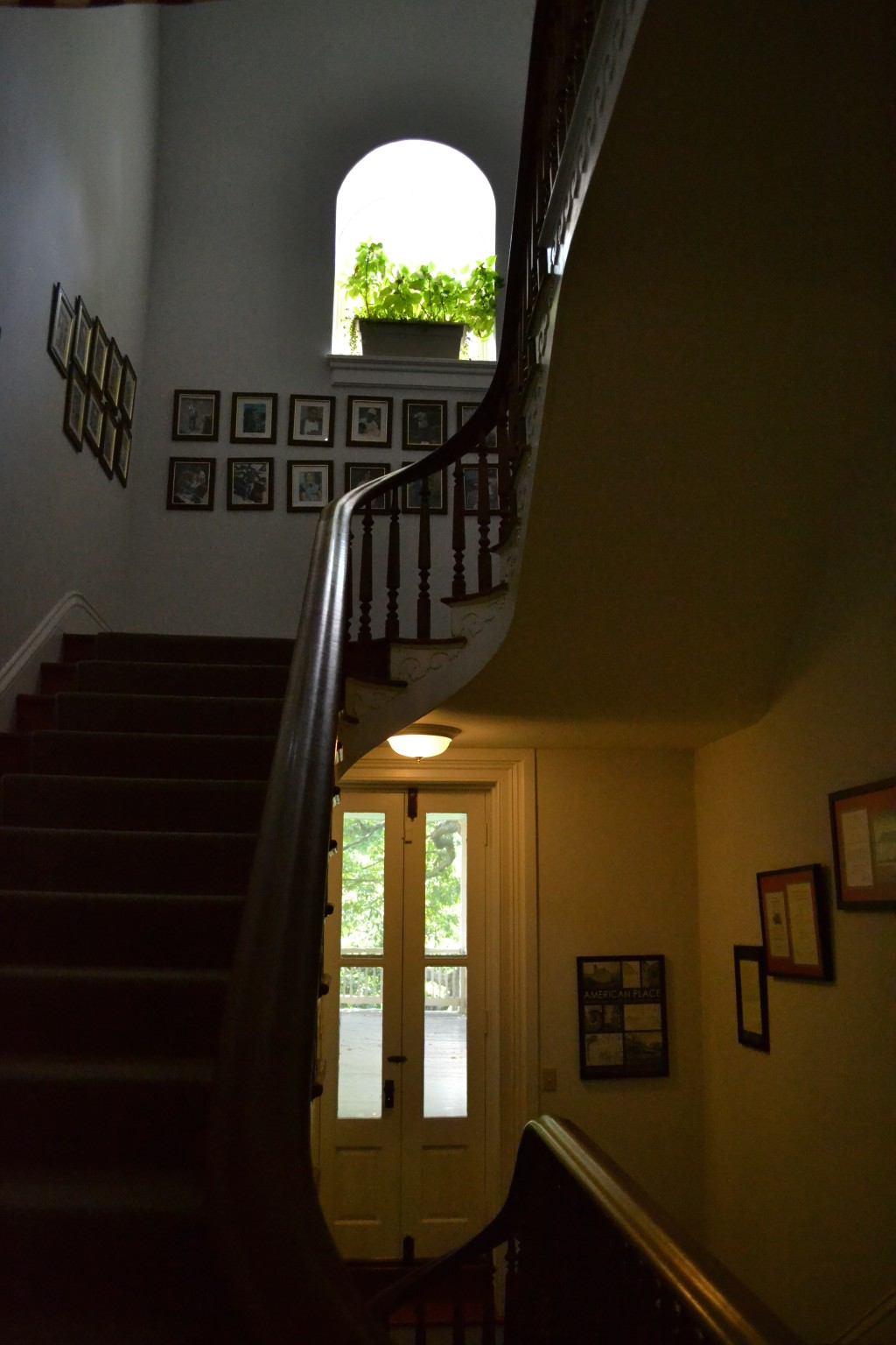 The stairway as it ascends from the second to the third floor.