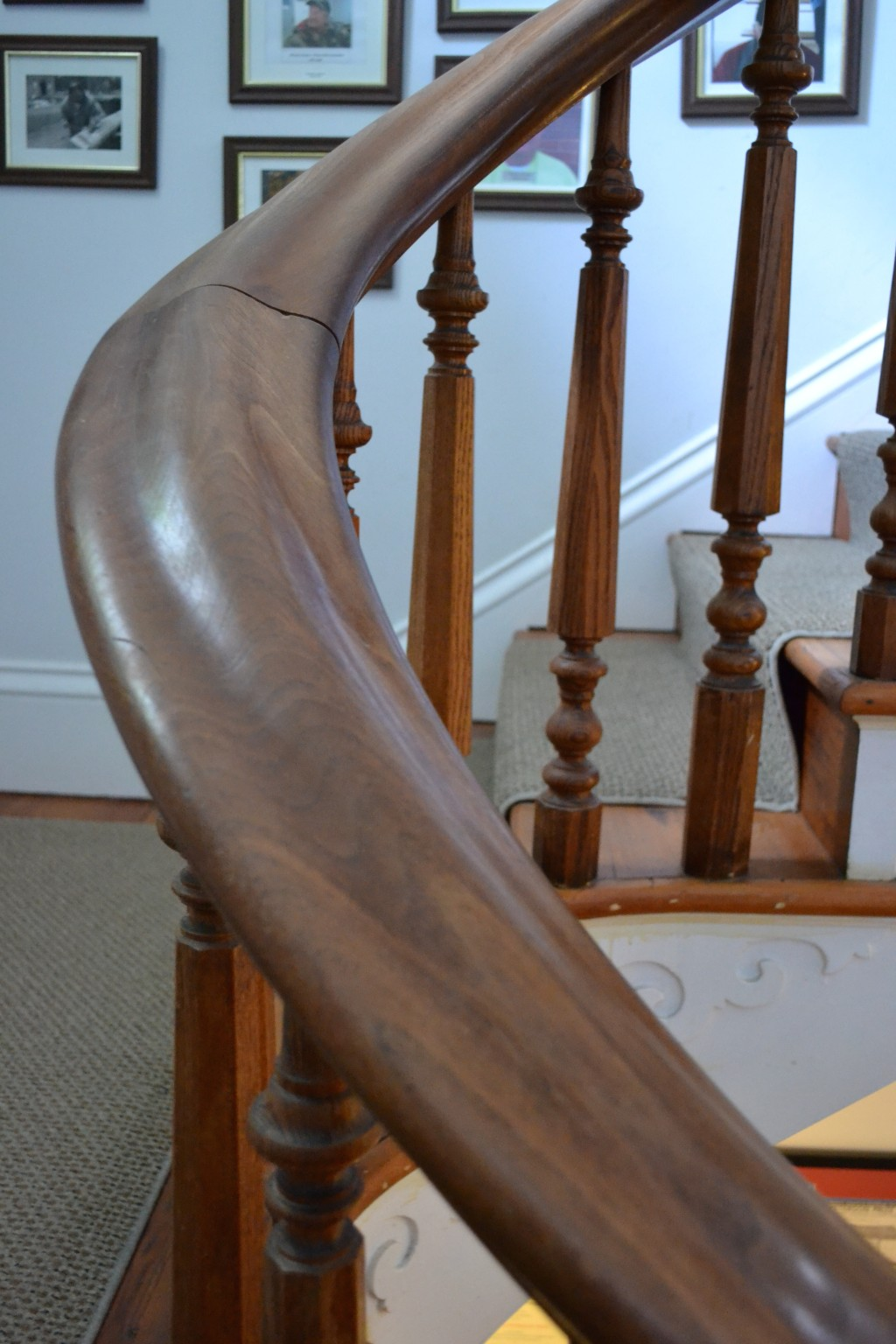 Detail of the curve of the grand stairway's bannister.