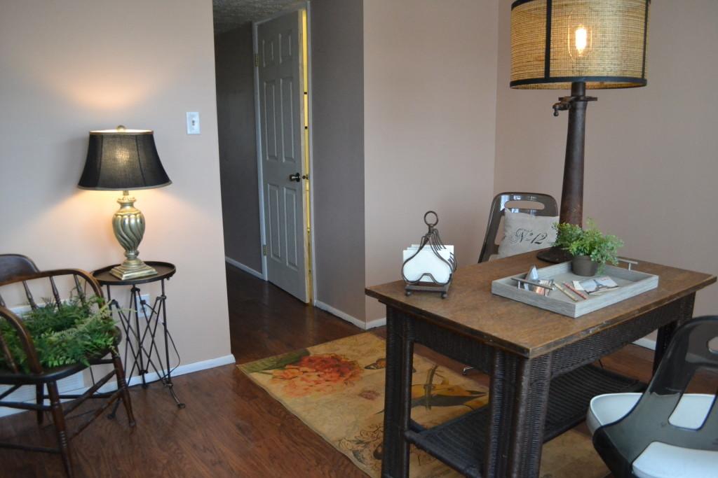Looking back down the hallway toward the living room and front door.
