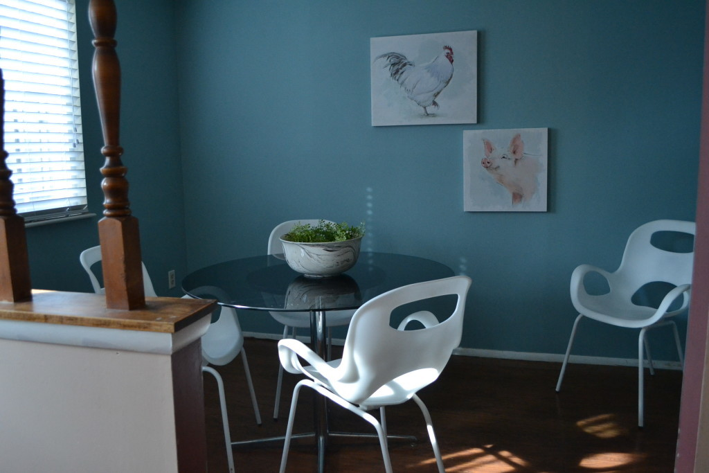 The dining room, enlivened with playful art and clean, modern furnishings (as seen from the study).