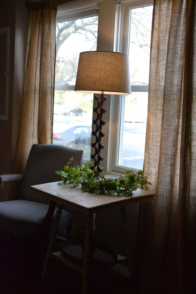 The front windows - brightened up with burlap curtains, and a comfortable seating area.