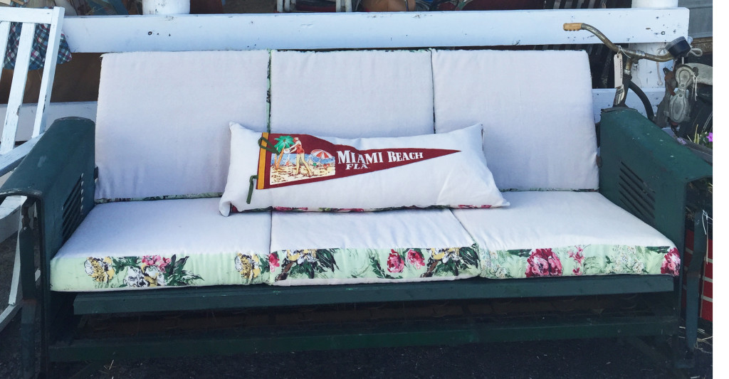 All-American glider. If you've never experienced a vintage porch glider, you haven't lived! Few things are as perfect a locale for a warm summer evening's drink with friends. This comfortable cotton upholstery, with the vintage fabric trim is spot-on perfect.