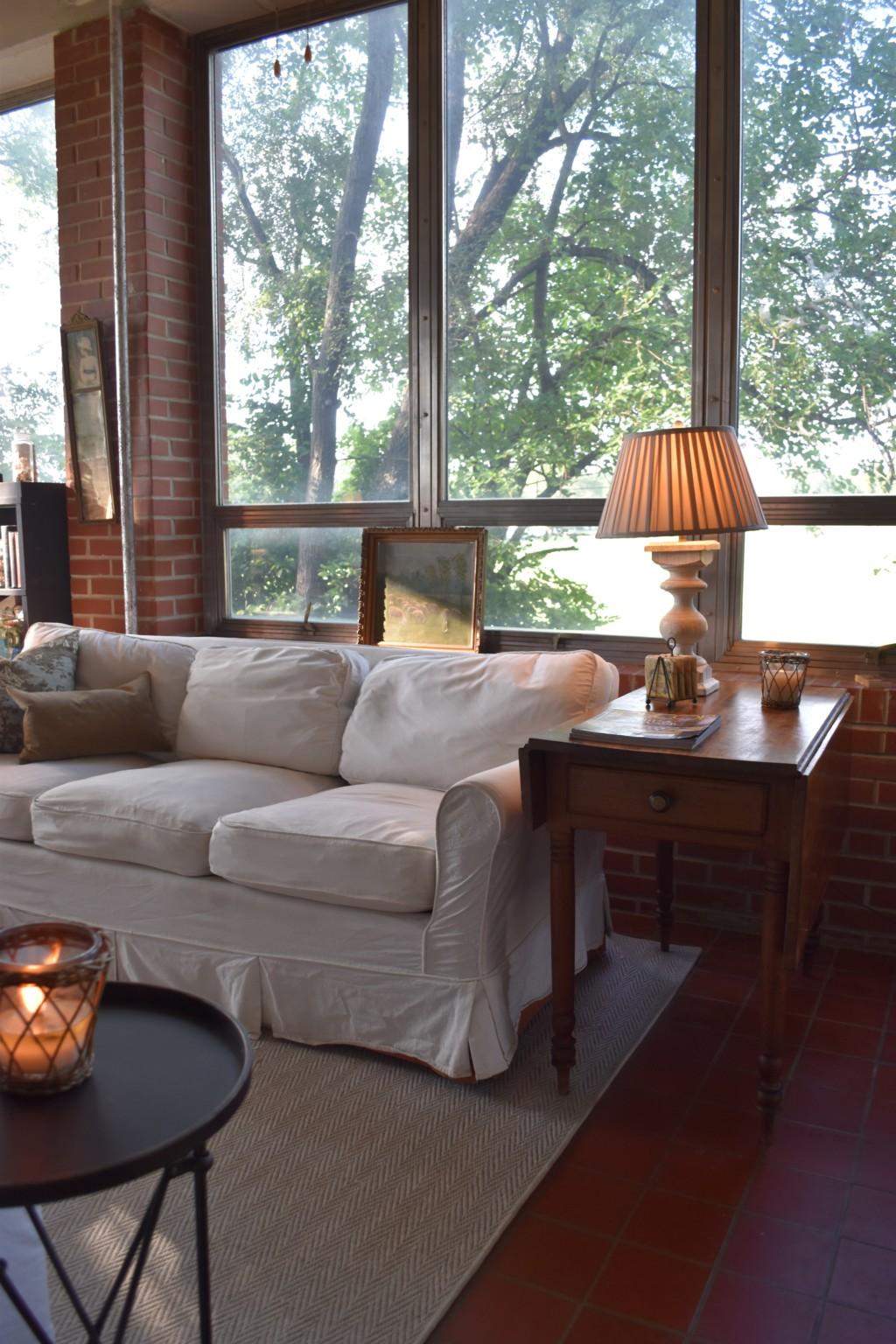 glass room, slip-covered sofa