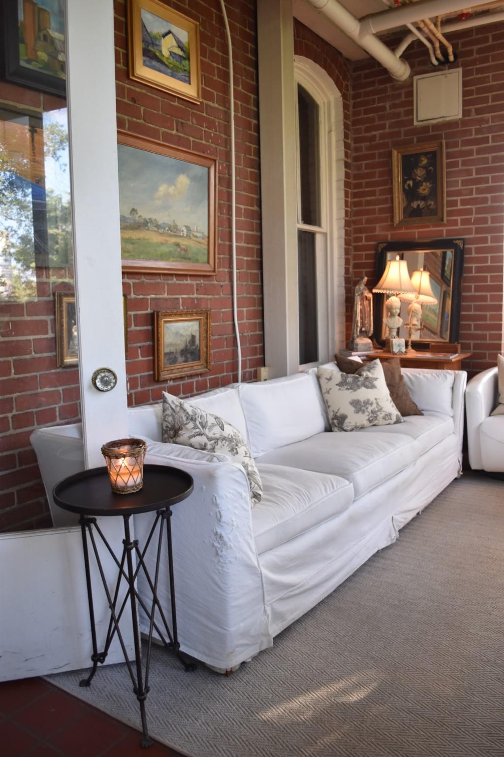 slip-covered sofa, wall of art