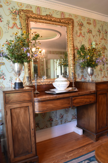 This stunning sideboard was purchased just for this spot in my parents' dining room. The gold mirror is one of my mother's signature touches.