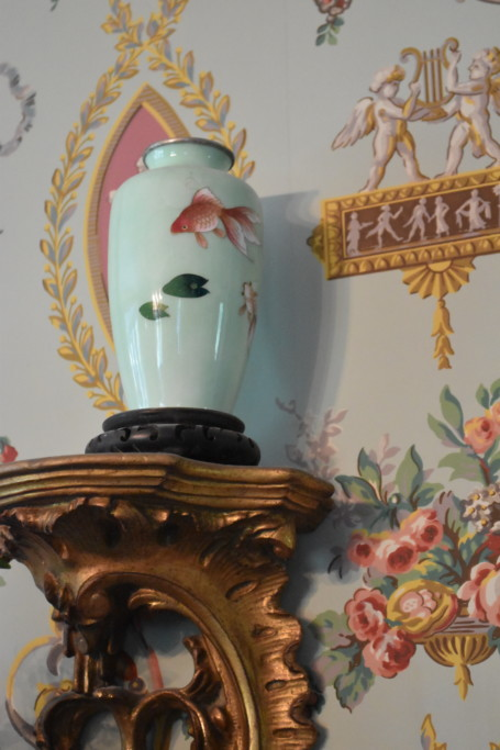 My father was posted in Korea in the early 1960s and brought a pair of these softly hued jars home with him. The colors were perfect for with the dramatic wallpaper my mother chose for the room, and these sweet golden sconces fit them perfectly.