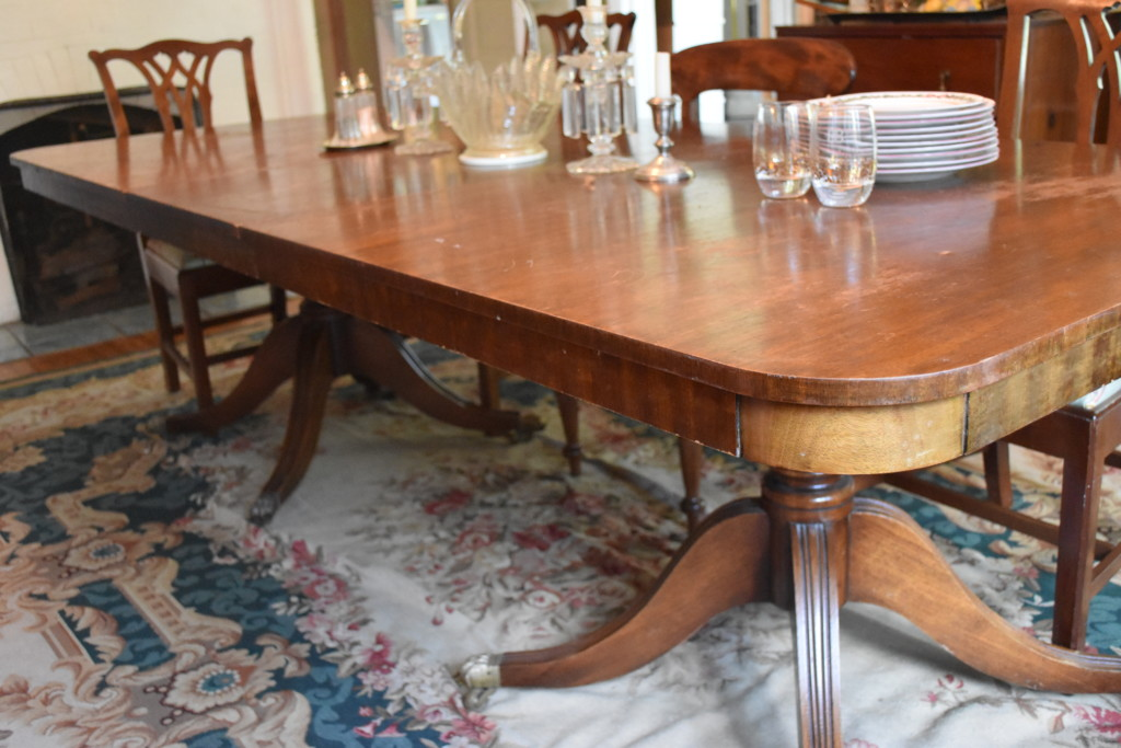 This beautiful mahogany dining table is from Belgium and comfortably seats 10.