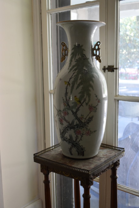 The living room, which opens onto the large wrap-around porch, has a pair of french doors on either side of the central fireplace. In front of each of these doors, these Chinese urns have been displayed.