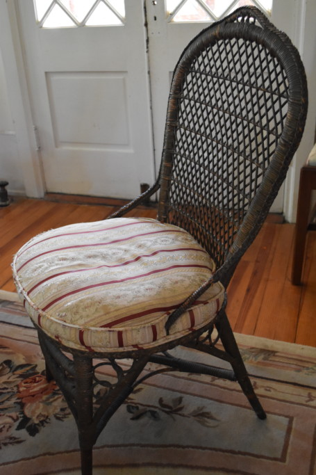 An exceptional late 19th century wicker side chair. This nicely detailed chair once called Boscabel home (my mother's family home). The chair has its original finish and wicker work, but my mother had it re-upholstered in a sublime, French silk stripe.