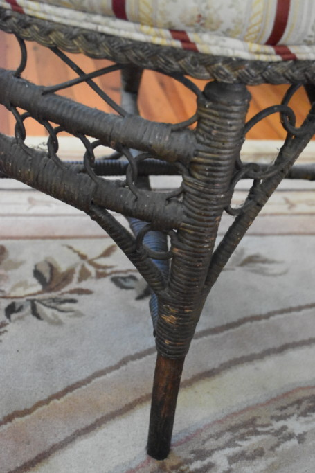 Detail of the wicker side chair's base and legs.