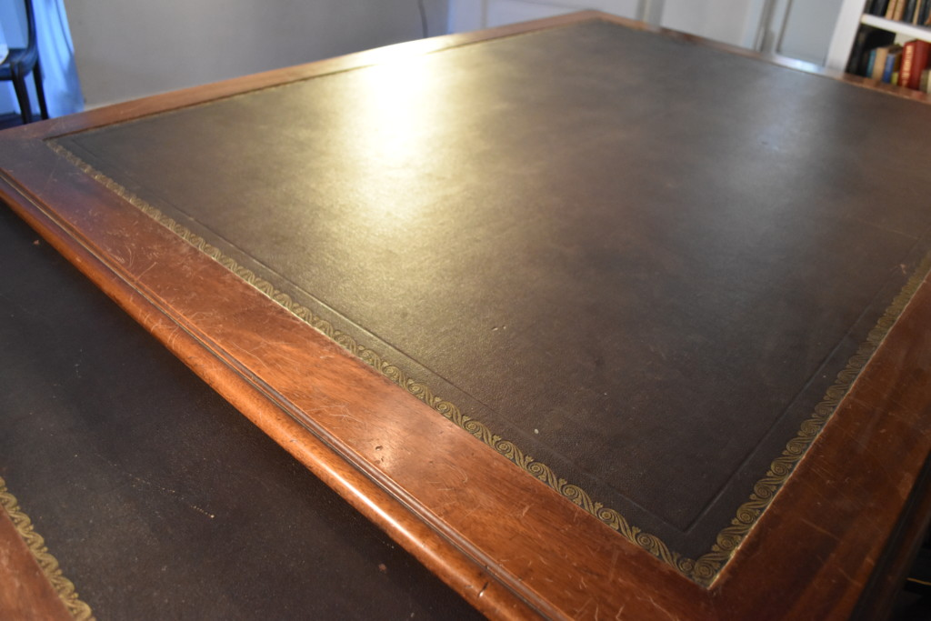 The expansive 5'x7' surface of the desk provided ample space of the pair of English partners who first used it. Look closely, and you'll see that this immense surface is created from one piece of wood. There are no seams.