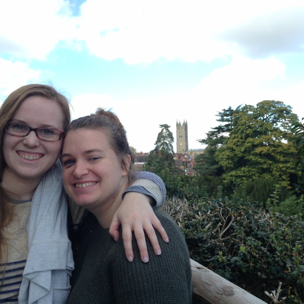 One of my favorite things about the British landscape: castles. Here are the girls on the walls of Warwick Castle, with the town and church in the background.
